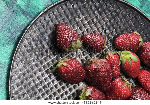 Fresh, sweet, tasty, useful, delicious, juicy strawberries closeup. The view from the top. Proper healthy eating
