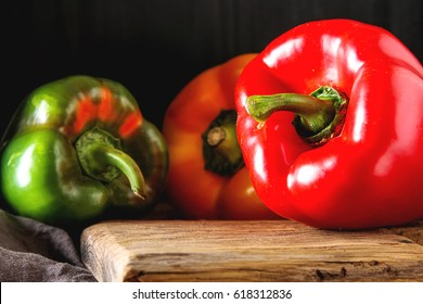Fresh sweet vegetables Red, Yellow, Green Peppers. Dark background