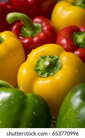 Fresh sweet yellow, green and red peppers. Vegetables macro