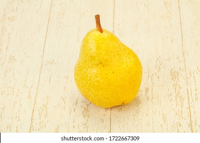 Fresh sweet yellow pear over background