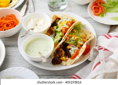 fresh taco with corn, vegetables, lettuce, food closeup