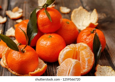 Fresh tangerine citrus or mandarin with leaves old wooden table