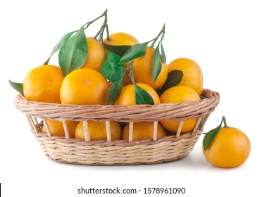 Fresh tangerines in a basket isolated on white.