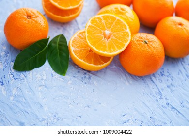 fresh tangerines on blue background - fruits and vegetables