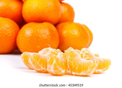 Fresh tangerines on a white background. Close up.