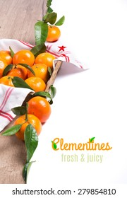 Fresh tangerines on wood isolated on white, space for your text