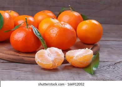 Fresh tangerines over wooden table