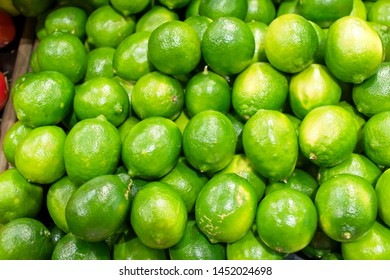 Fresh, tangy Limes on display at a grocery store.