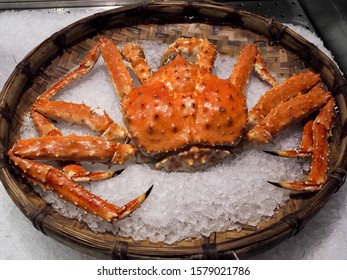 Fresh Taraba red king crab steamed serve on ice in bamboo plate