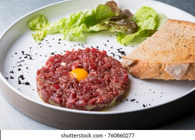Fresh tartar meat dish with yolk and crouton