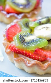 Fresh tarts with mixed fruits background