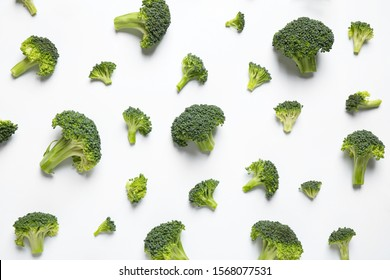 Fresh tasty broccoli on white background, top view