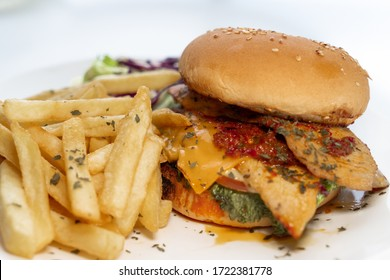 Fresh tasty burger and french fries with special sauce on white plate and white background. Food photography. Isolated