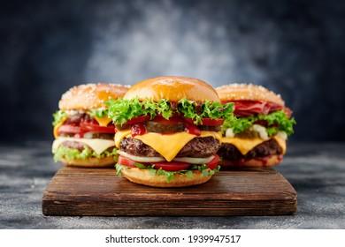 Fresh tasty burger on dark background