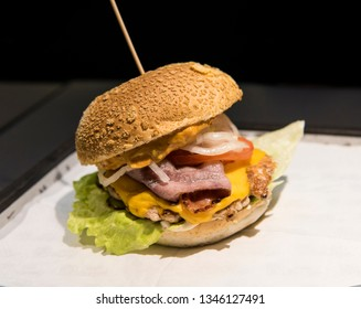 Fresh tasty burger on a wooden table