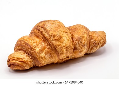 Fresh and tasty buttery croissants isolate on white background.