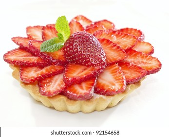 Fresh and tasty cake with strawberry against white background