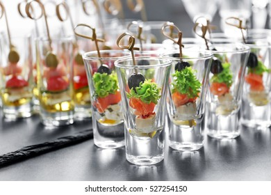 Fresh tasty canapes on table