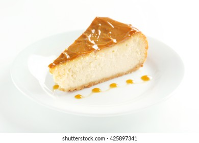 Fresh and tasty caramel cheesecake on white plate