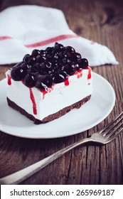 Fresh tasty cheesecake with blackberry on a plate, creamy dessert