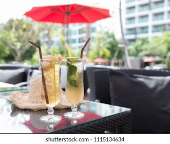 Fresh and tasty cocktail drinks on the table in the outdoor restaurant