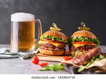 Fresh tasty Craft Burger cooking with beef, tomato, cheese, cucumber and lettuce over grey concrete background