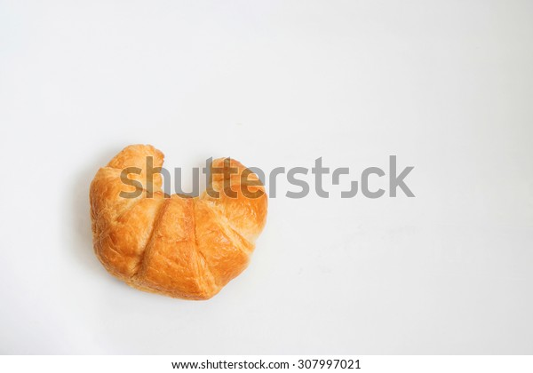 fresh and tasty croissant on white background