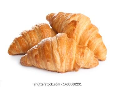 Fresh tasty croissants on white background. French pastry