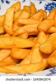 Fresh tasty fried potatoes - appetizing food background. French fries, or simply fries, chips, finger chips, or french-fried potatoes, are batonnet or allumette-cut deep-fried potatoes.