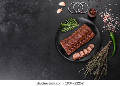 Fresh tasty kebab grilled with spices and herbs. Grilled meat dish