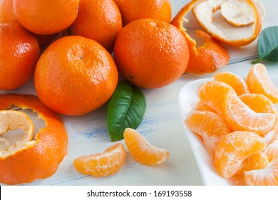 Fresh and tasty mandarins on wooden table