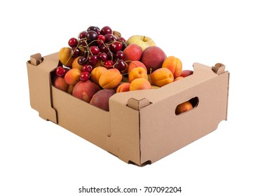 Fresh and tasty organic fruits in cardboard box, isolated on white