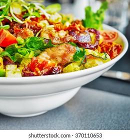 Fresh and tasty salad on plate