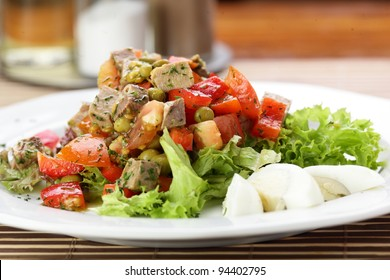 Fresh and tasty salad on the wooden table
