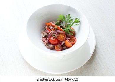 Fresh and tasty salad in white dish