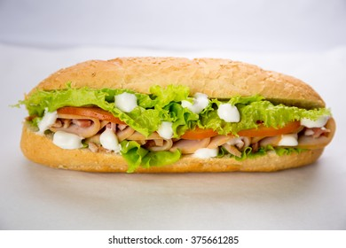Fresh and tasty sandwich with ham and vegetables