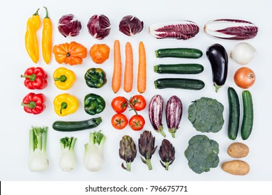 Fresh tasty seasonal vegetables on white background, healthy eating concept, flat lay