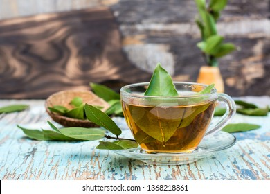 Fresh tea from bay leaf in a cup on a wooden rustic table