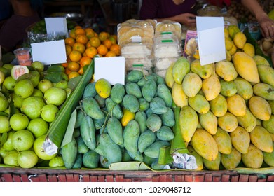 Fresh Thai fruit mangoes, guavas and oranges ready for sale at floating market