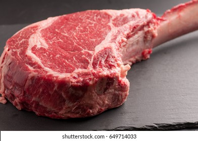 fresh thich cut tomahawk cut beef steak, raw and uncooked