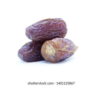 Fresh three Medjool dates isolated on white background