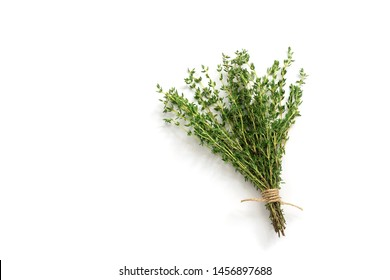 Fresh thyme herb on white background. Bouquet of thyme isolated. View from above