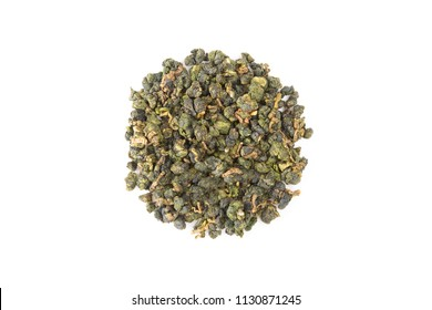 Fresh Tieguanyin Loose Oolong tea of high quality grade mountain growing  in circle pile on white table background for hot or cold drinks, close-up shot