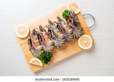 fresh tiger prawn or shrimp on wood board
