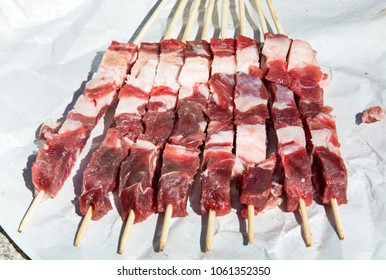 Fresh tipical Abruzzo's sheep skewers: Arrosticini. Outdoor in a sunny day