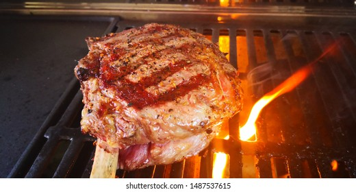 Fresh tomahawk seasoning cook on BBQ and grill on flame