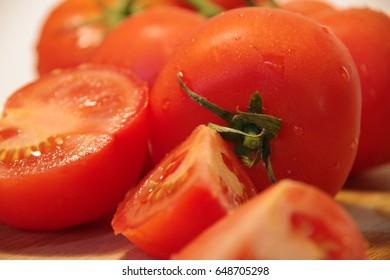 Fresh tomato cuts closeup