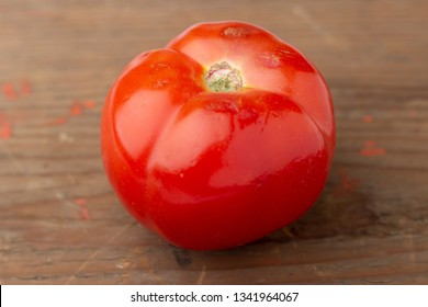 Fresh tomato isolated on wooden board
