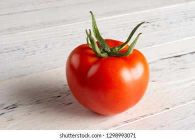 fresh tomato on white wood table