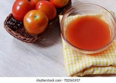 Fresh tomato sauce on the bowl made originally from tomatoes placed on rattan basket